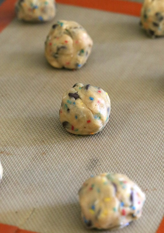 Roll the cookie dough into balls and bake!