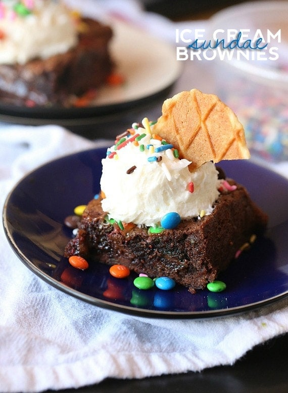 Ice Cream Sundae Brownies...a rich caramel brownie loaded with M&Ms and topped with frosting that looks like ice cream!