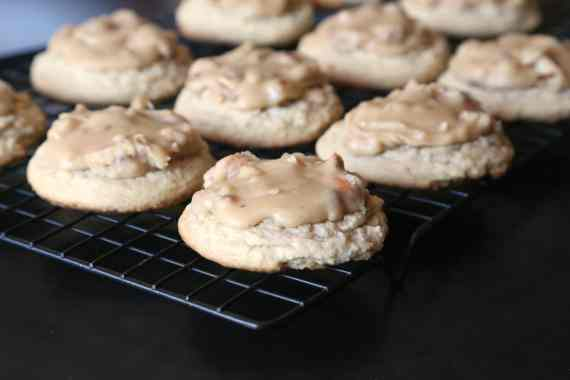 Praline Cookies...A delicious brown sugar cookie that is so sft with praline frosting on top. If you love pralines you will LOVE these cookies!