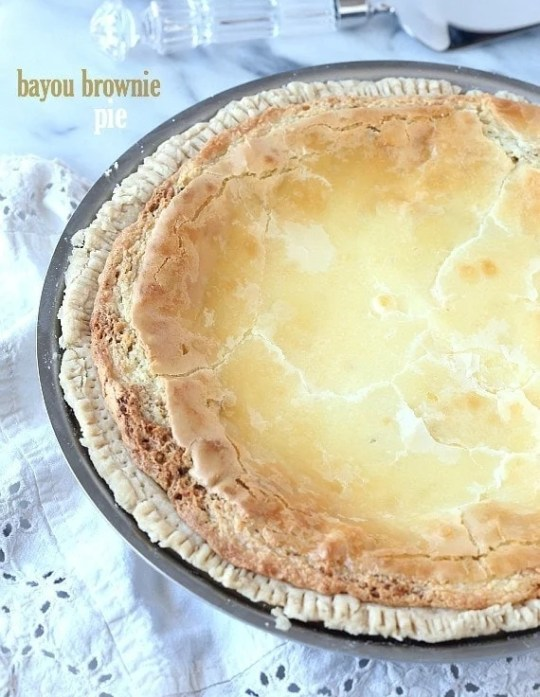 Bayou Brownie Pie...This pie is CRAZY good! Its a buttery blondie-brownie filling with an ooey gooey cream cheese topping!
