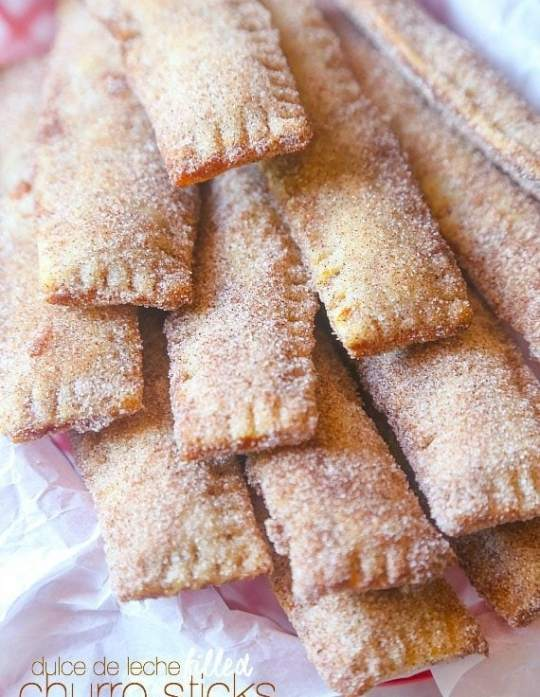 These Dulce de Leche filled Churro Sticks are so simple, crispy and cinnamon sweet! Perfectly portable so they're great for a party!