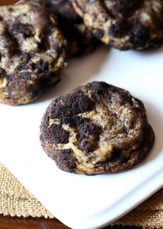 Dirty Chocolate Chip Cookies...these are super soft choclate chip cookies loaded with Oreo bits ROLLED in Oreo dust! LOVE these!