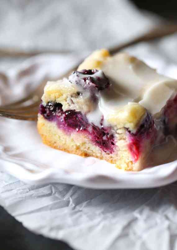 These soft Glazed Berry Sugar Bars are bursting with summer berry flavors! The cookie is soft and buttery, the berries are sweet and flavorful and it's all topped with a creamy sugar glaze!