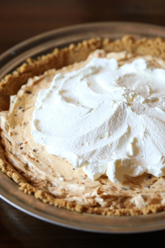 Making Butterfinger Pie in a graham cracker crust!