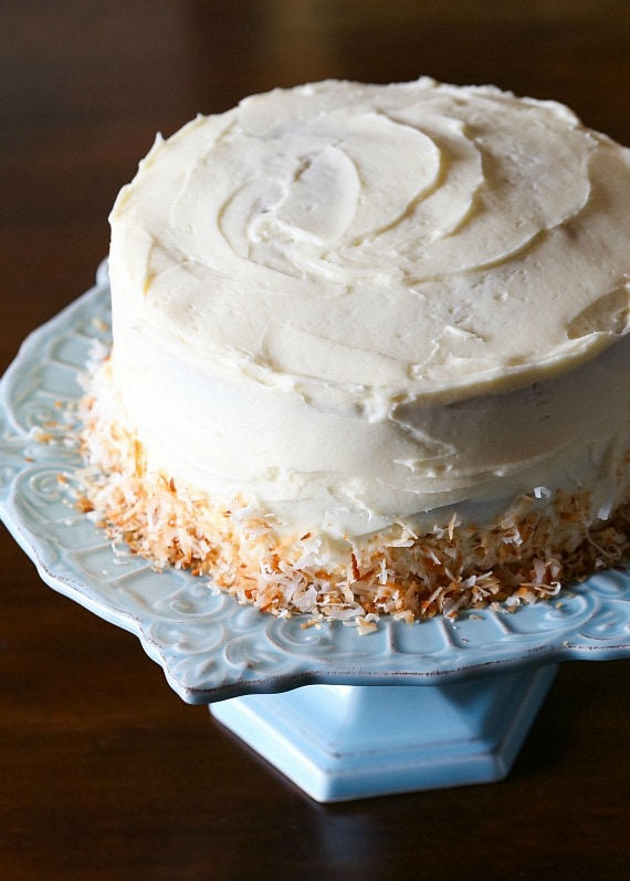 This is THE Best Banana Cake recipe! It's so soft, easy to make and perfectly sweet! Top it with cream cream cheese frosting! I LOVE it! You can leave off the toasted coconut on the outside too!