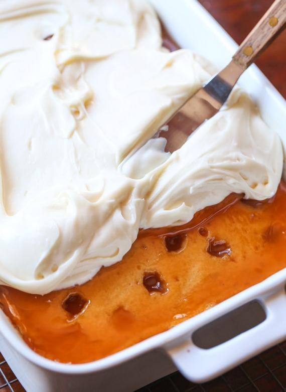 Caramel Cake topped with creamy cream cheese frosting.