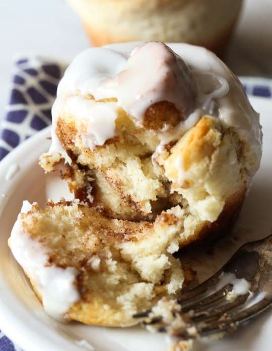No Yeast Cinnamon Roll Muffins! The gooiest part of the cinnamon roll made quick with no yeast necessary!