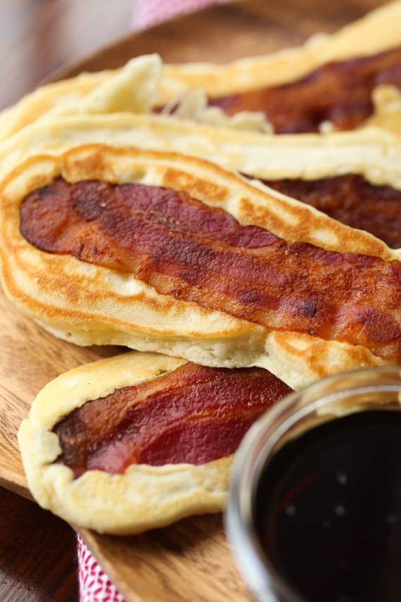 Pancake Bacon Dippers! A soft pancake surrounds a crispy piece of bacon that you can dip right in maple syrup!