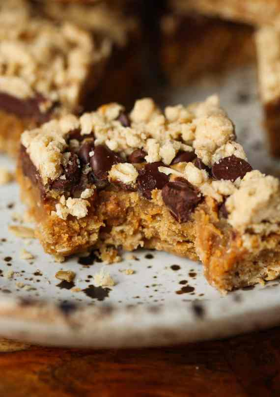 Peanut Butter Passion Bars... a buttery oat bar with a sweet peanut butter caramel filling topped with chocolate chips and more crumble!