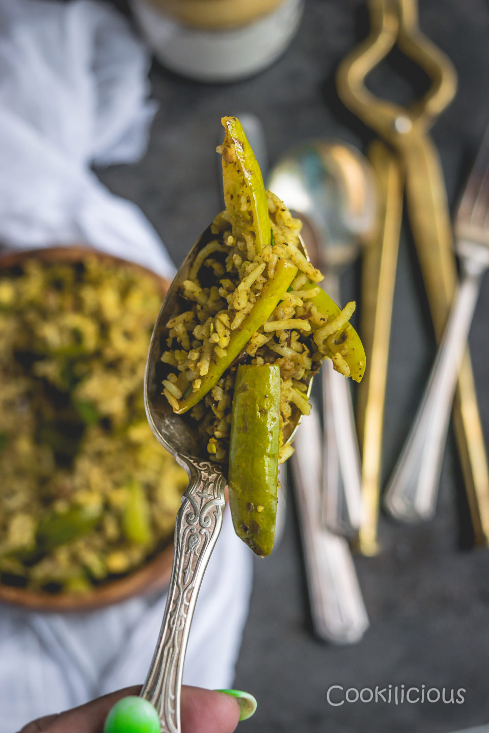 close up shot of a spoonful of Tendli Masala Bhaat | Ivy Gourd Masala Rice