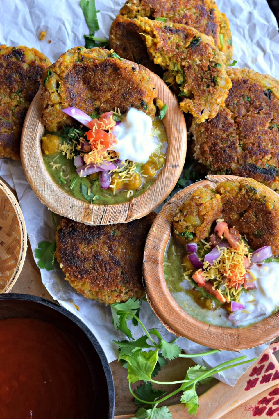 Spicy Sweet Potato Tikki With Chole Chaat is a healthy twist to the traditional Bombay Chaat. Sweet potato fritters are served with chickpea curry & sauces.