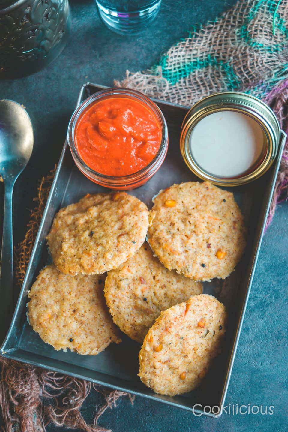 A tin box filled with Instant Sweet Potato & Quinoa Idli/Steamed Cakes