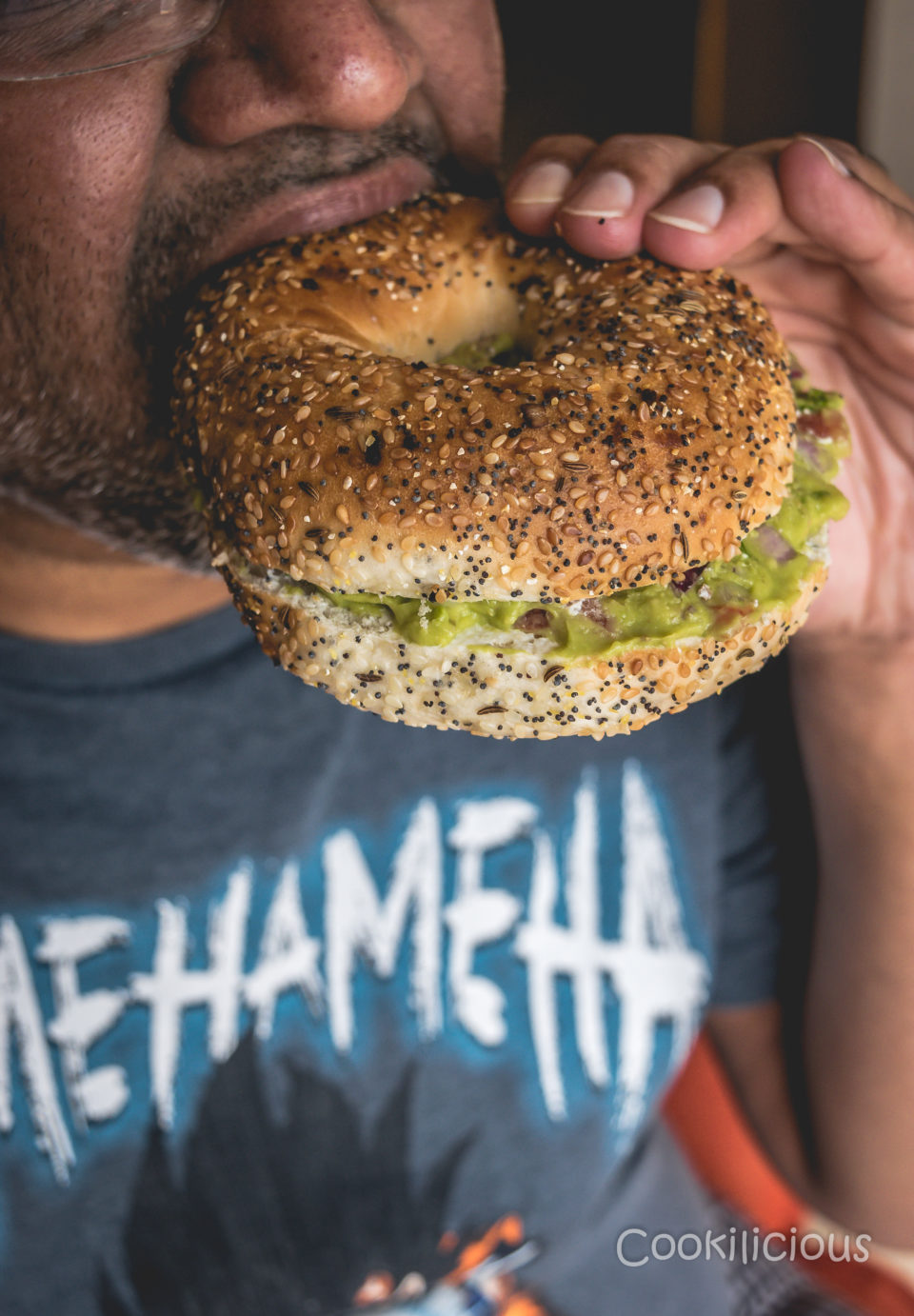 a man eating Bagel Sliders with Homemade Guacamole for Breakfast!