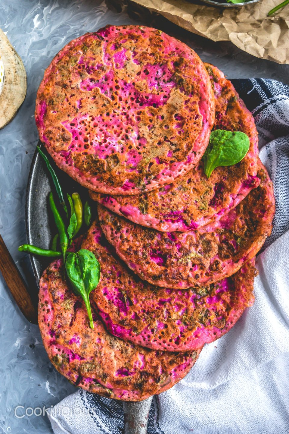 a neatly stacked Pink Uttapam with Beets & Veggies on a tray