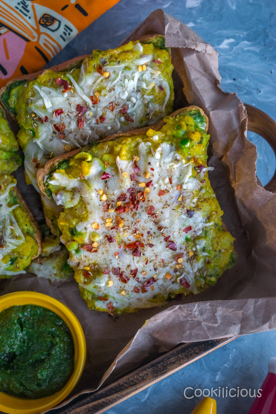 2 Potato Chilly Garlic Masala Toast placed over crumpled paper