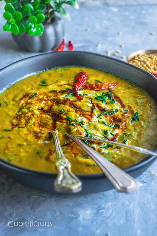side angle shot of Malvani Style Tikhat Dal in a bowl