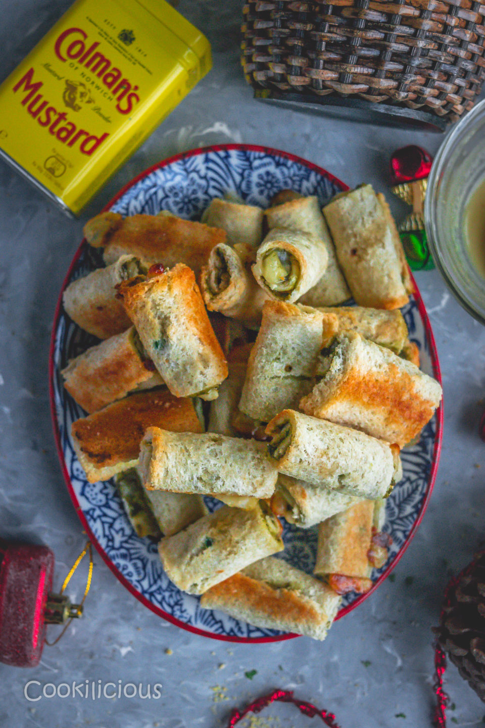 flat lay image of an oval tray filled with Baked Bread & Chutney Rolls