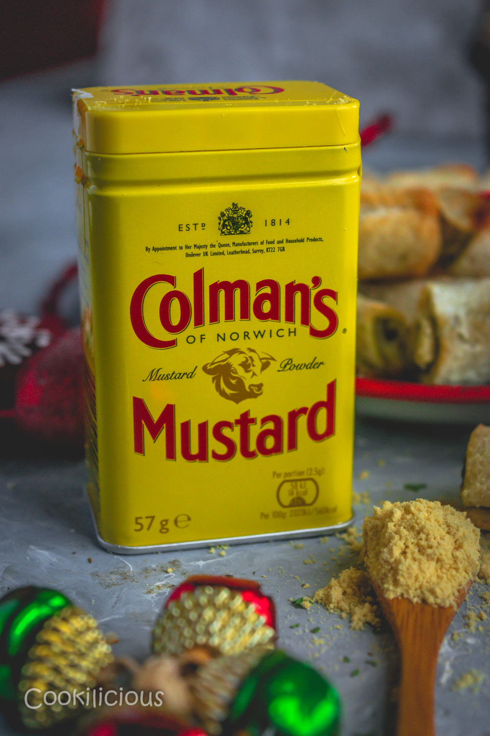 close up shot of a box of Colman's Mustard powder used to make Baked Bread & Chutney Rolls