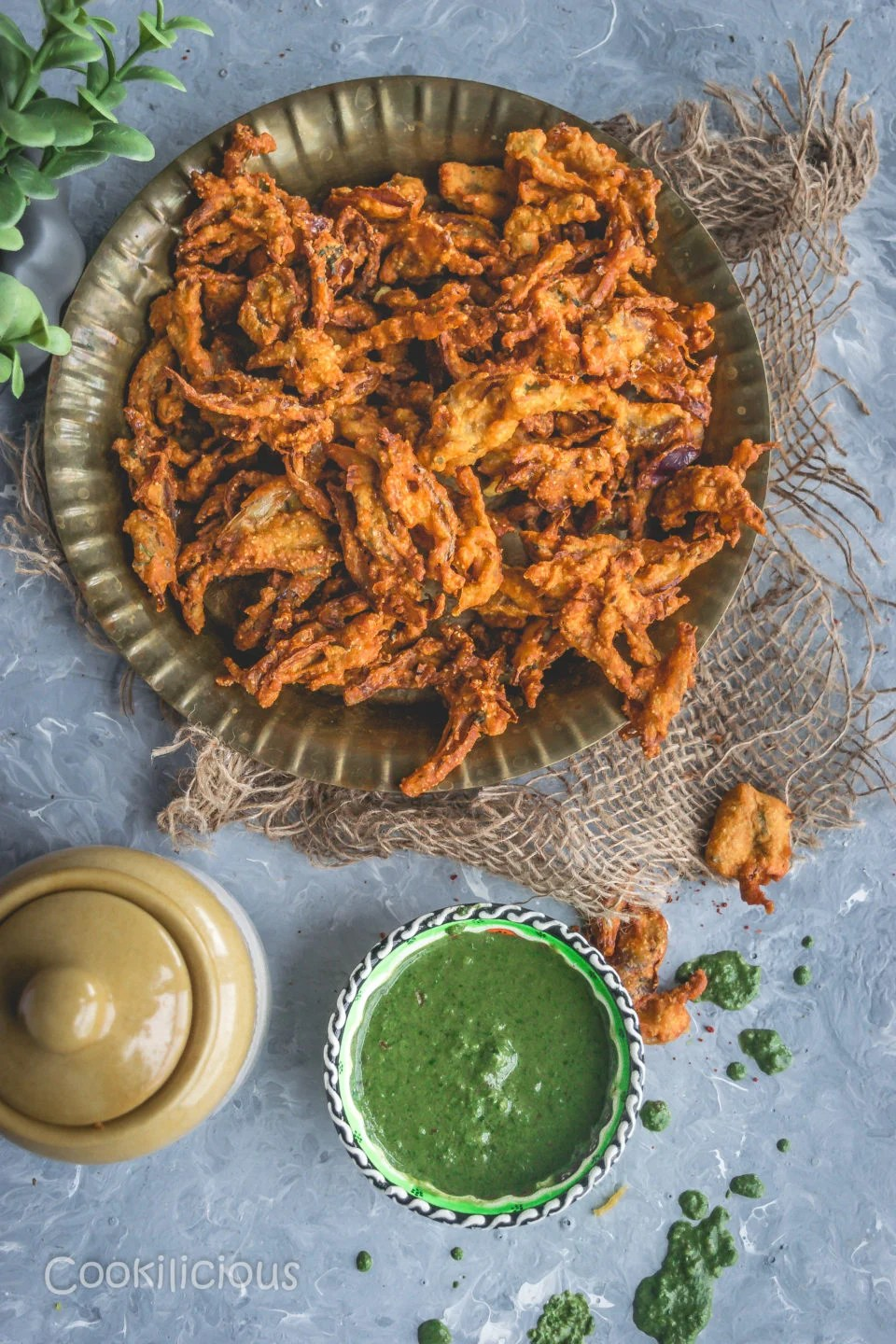 a plate filled with Vegan Crispy Onion Pakoda | Fried Kanda Bhajiya with chutney on the side
