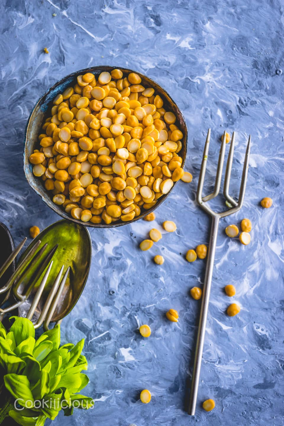 chana dal in a bowl with a fork next to it before soaking it to make Steamed Chana Dal Lentil Bafauri