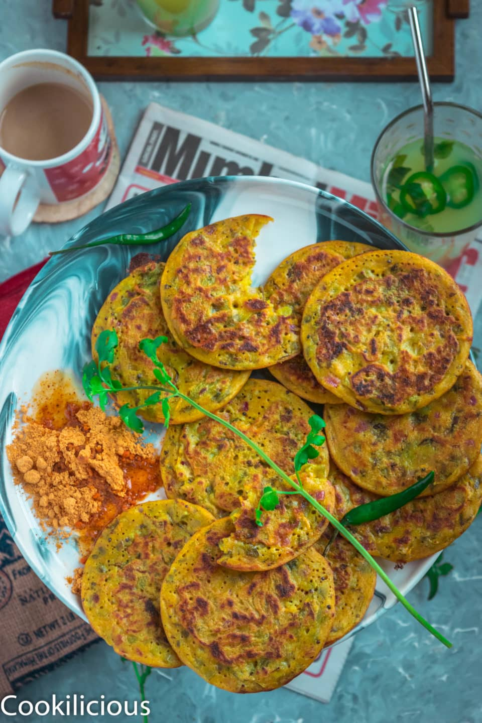 Mini Masala Uttapam served in a plate with molagopodi on the side