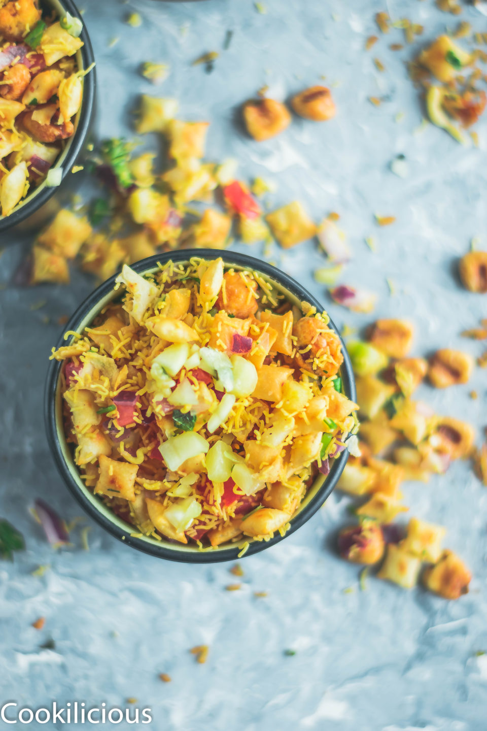 top angle shot of one bowl filled with 2 bowls containing Crispy & Masaledar Cheeselings Bhel