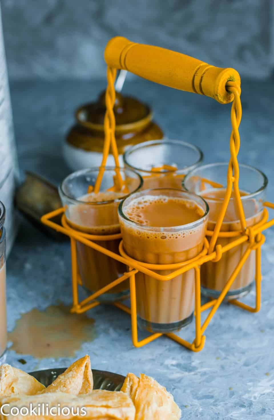 4 cups of masala chai resting in a chai stand