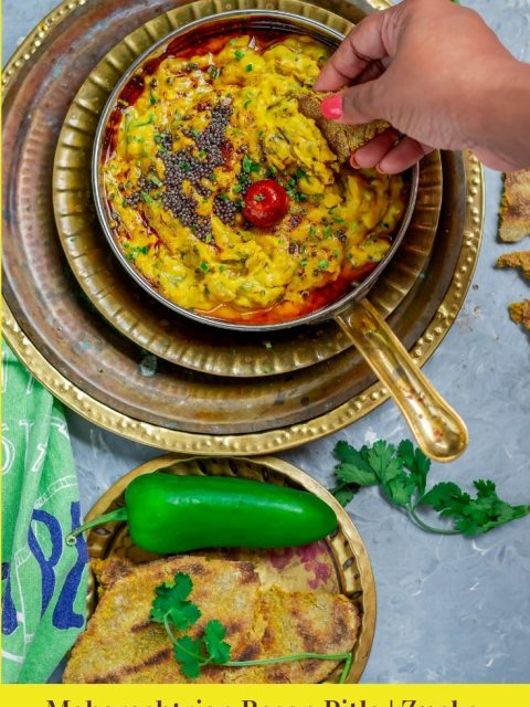 Besan pitla in a bowl and a hand reaching out into it with a piece of bhakri and text at the bottom