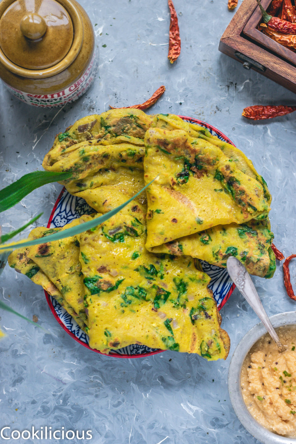 4 folded Moong Dal & Palak Chilla in a plate