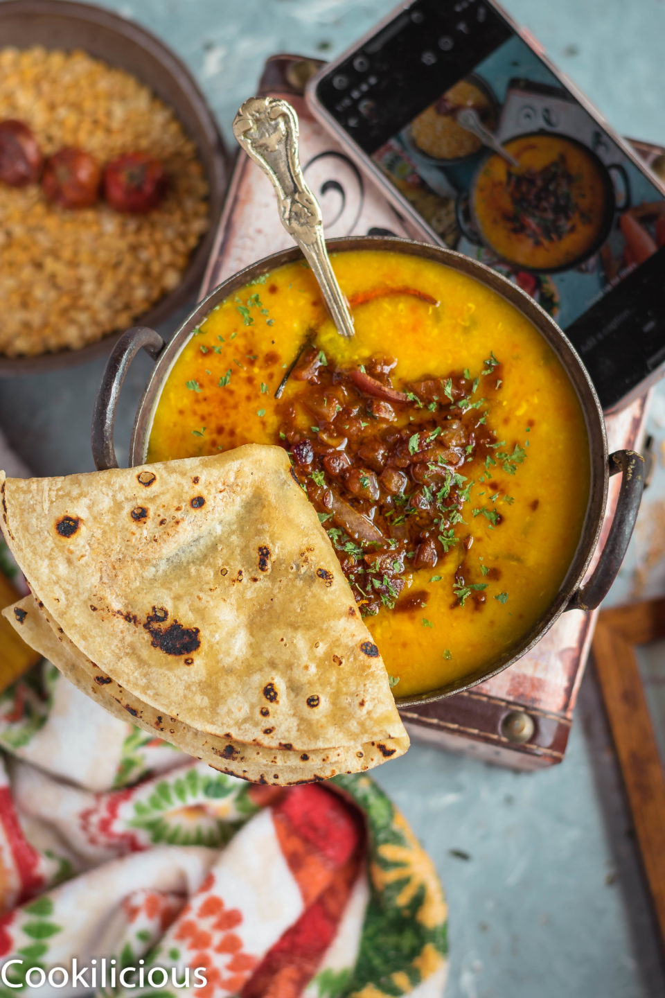 Roasted Lentils & Carrot Dal With Spinach in a kadai with a folded chapati next to it