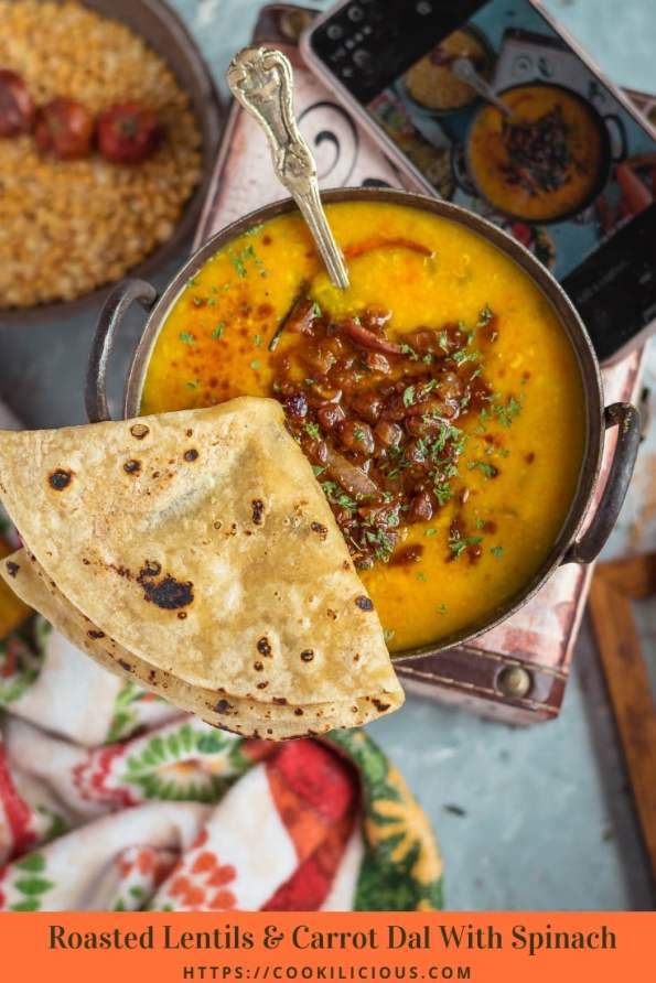 Roasted Lentils & Carrot Dal With Spinach in a kadai with a folded chapati next to it and text at the bottom