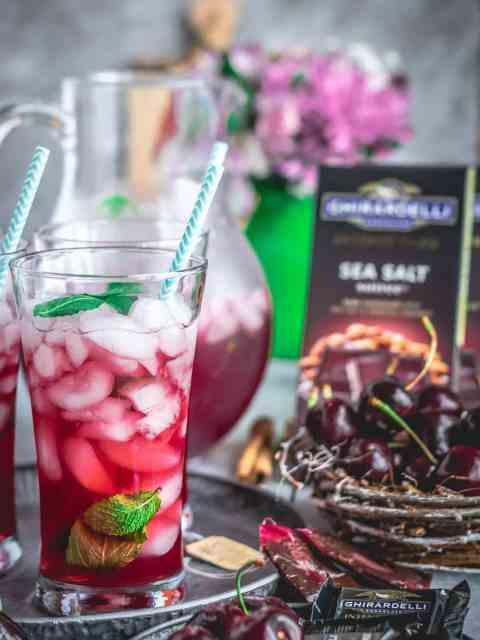 Cherry Lemon Iced Tea in a glass with dark chocolate bar on the side