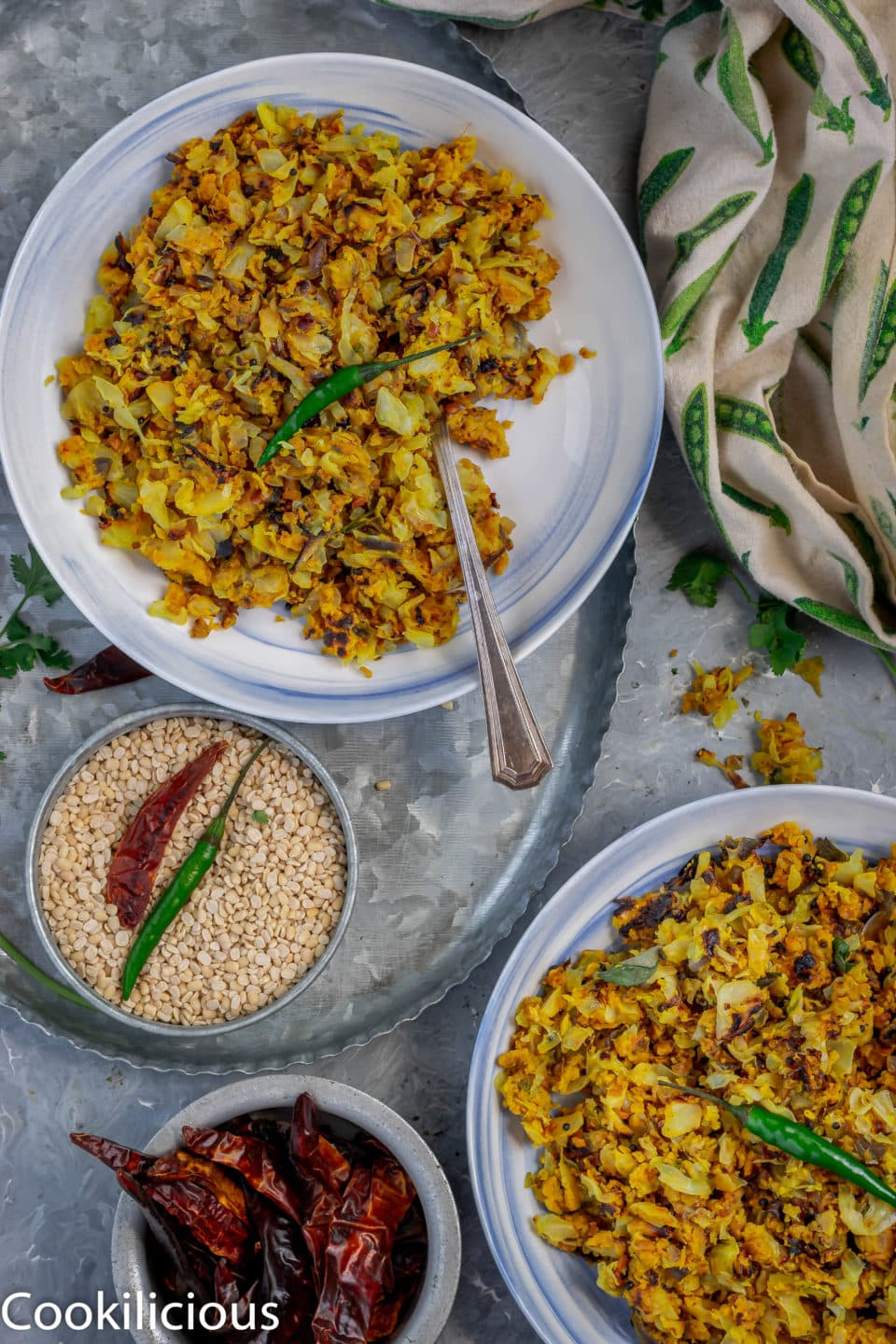 flat lay imahe of two bowls of Cabbage & Chickpea Flour/Besan Stir-Fry