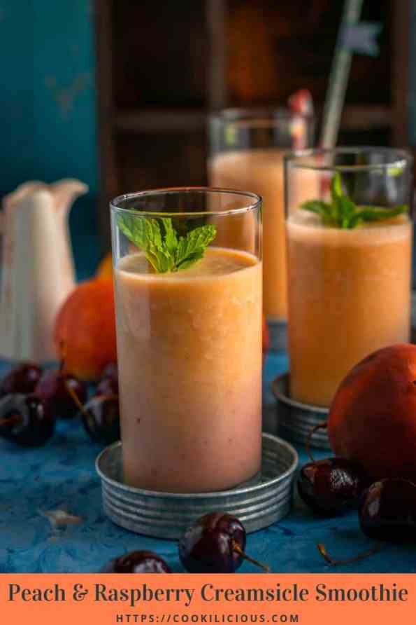 a table set up with glasses of Peach & Raspberry Creamsicle Smoothie and text at the bottom