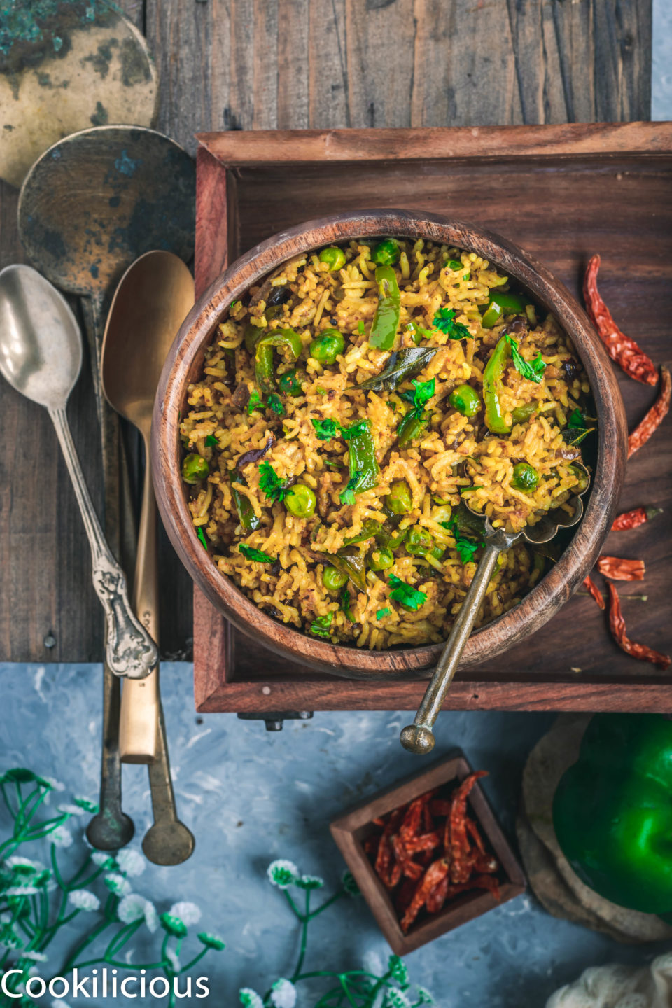 Bell Pepper Fried Rice in a wooden tray with a set of cutlery on the side