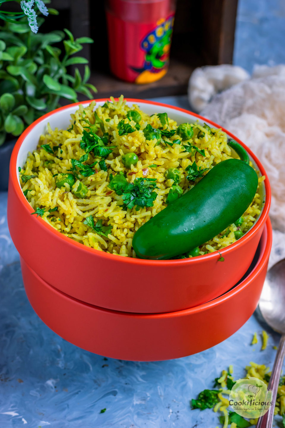 3 bowls one on top of the other and the top one filled with Green Peas Pulao