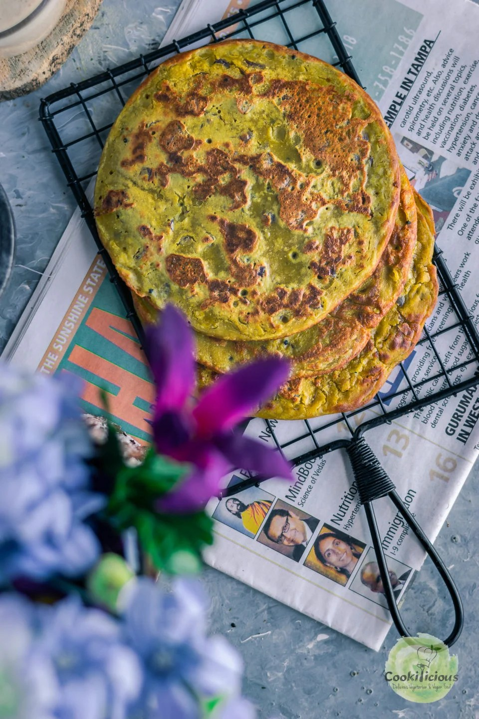 top view of Lentil Pancakes with Leftover Dal over a wire rack