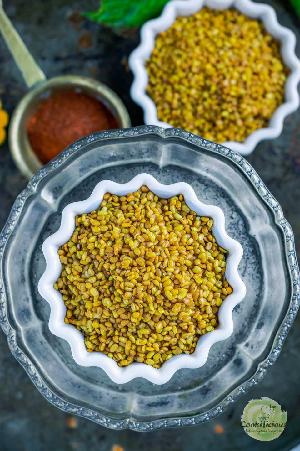 a bowl of Crunchy Moong Dal placed over a plate