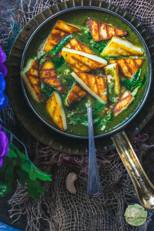 grilled paneer pieces over palak paneer bowl