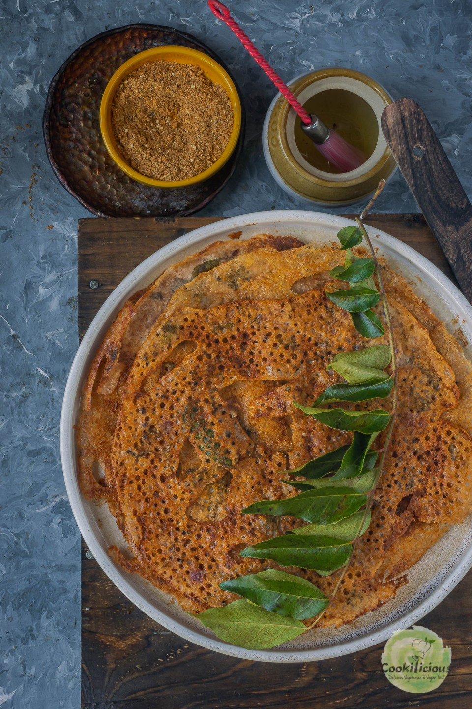 a round plate with Wheat Dosa | Instant Wheat Rava Dosa in it