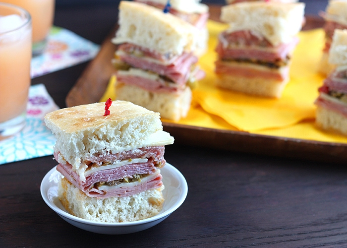 Bite-sized mini muffulettasandwiches are loaded with sliced meat, cheese, and salty olive salad. These appetizers are loaded with a taste of New Orleans.