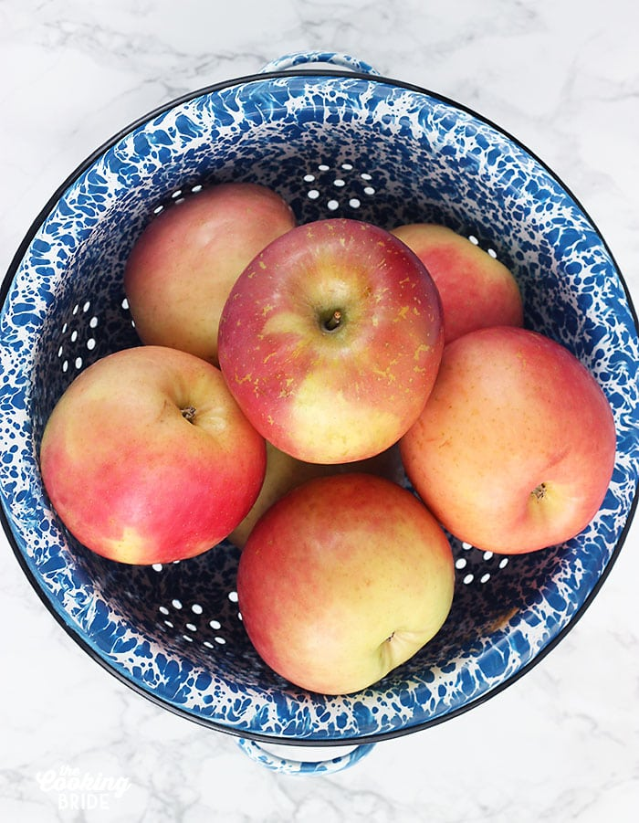 Fuji apples in a blue and white colander