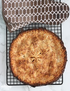cooked granny smith apple pie cooling on a rack