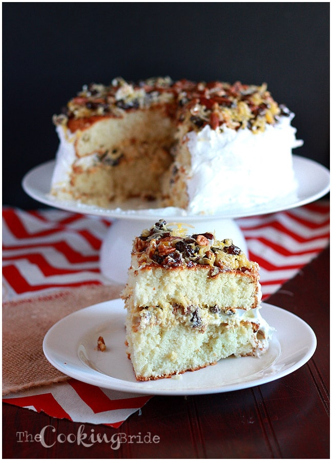 A forgotten Southern classic, Amalgamation cake is filled with raisins and coconut, iced with homemade frosting and garnished with more coconut and raisins.