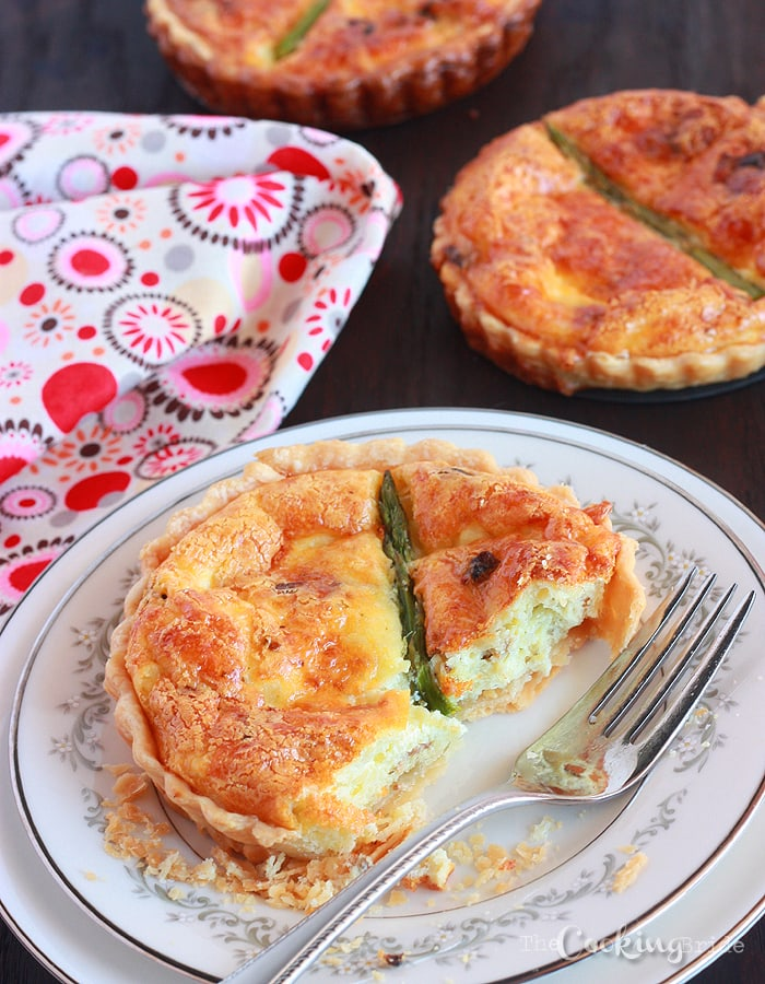 asparagus quiche cut into with a fork