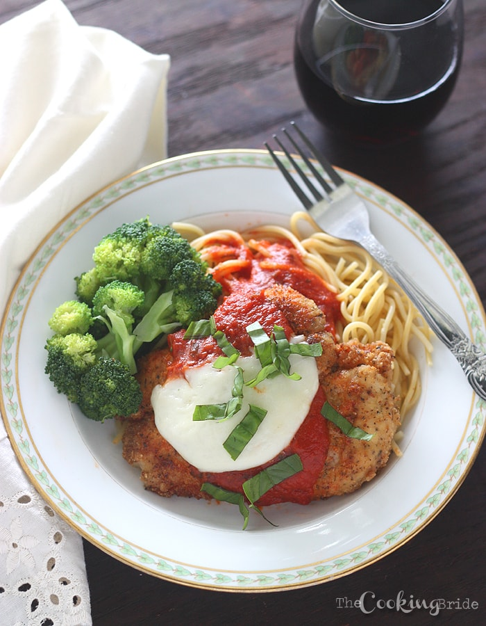 This easy chicken Parmesan recipe is simple enough for a weeknight meal! Chicken cutlets are dredged in egg, breadcrumbs, and Parmesan cheese, then fried until crispy and golden brown.