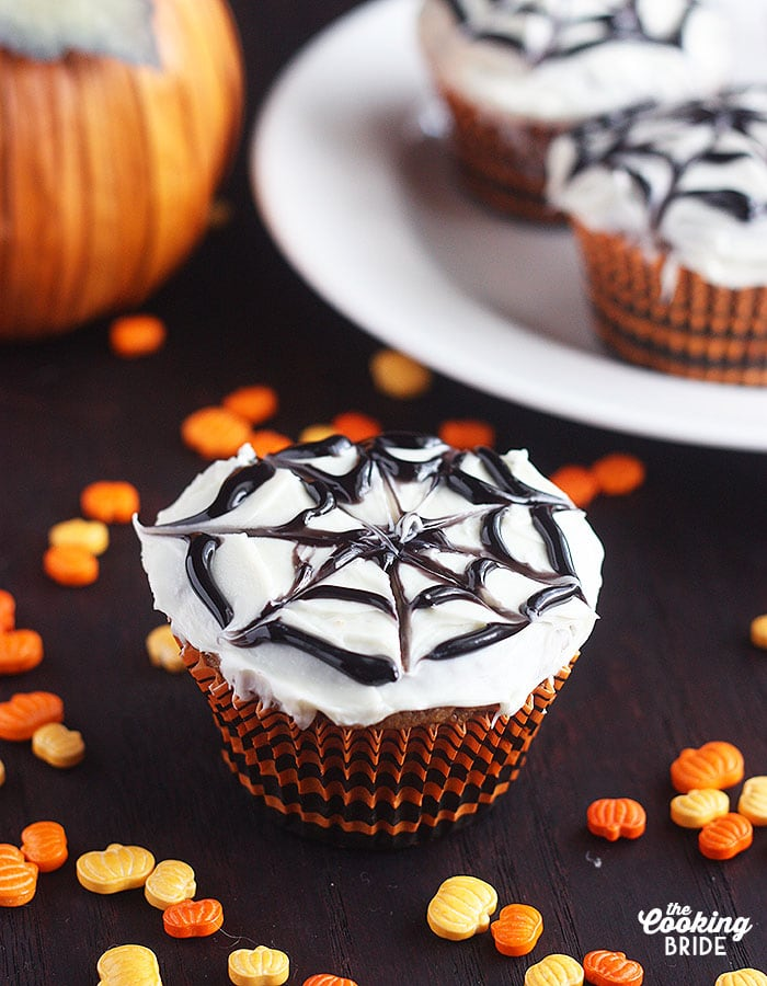 Easy pumpkin spice cupcakes have a sweet Nutella center. Easy tutorial for creating a spooky spider web design for Halloween!