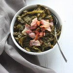 Try this set it and forget it recipe for slow cooker collard greens.Collards are slowly simmered with bacon until tender for a truly tasty Southern side.