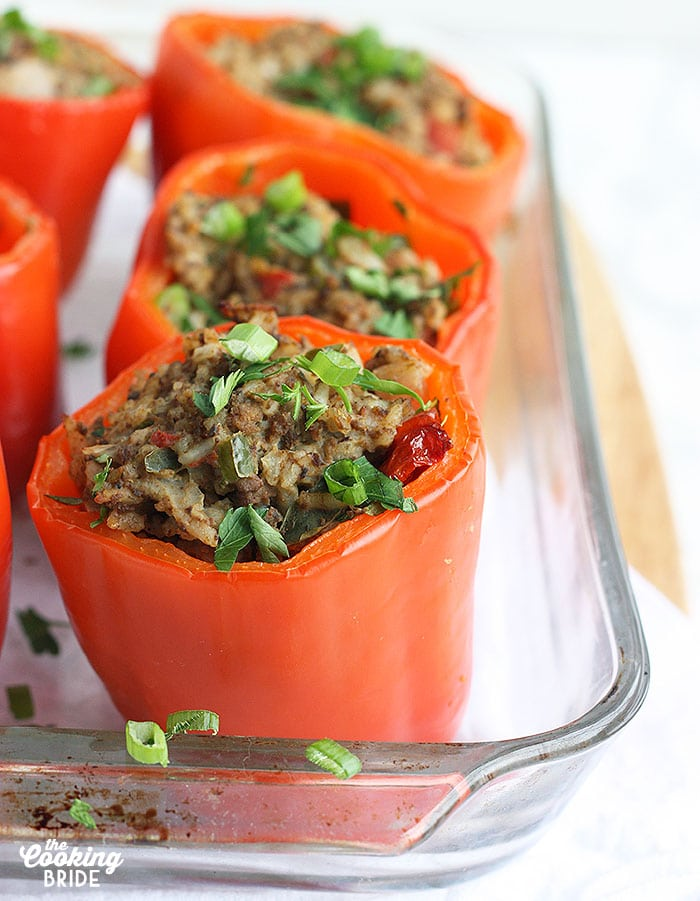 cooked stuffed bell peppers in a casserole dish