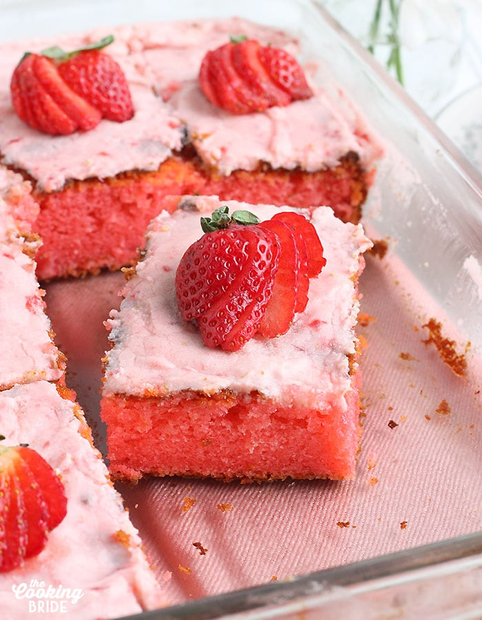 close up shot of a slice of strawberry sheet cake